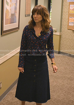 Judy's navy heart print blouse and denim skirt on Dead to Me