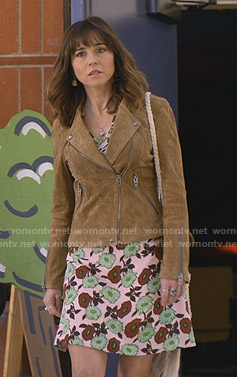 Judy's pink floral dress and suede moto jacket on Dead to Me
