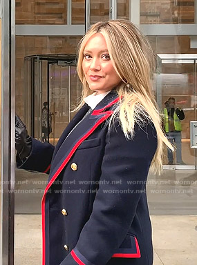 Kelsey's navy coat with red piping on Younger