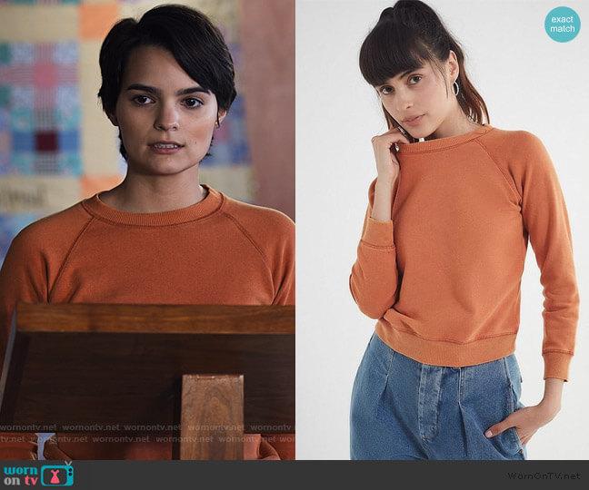 Stevie Shrunken Sweatshirt by Urban Outfitters worn by Elodie Davis (Brianna Hildebrand) on Trinkets