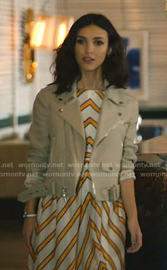 Alicia's white and orange striped dress and beige jacket on Grand Hotel