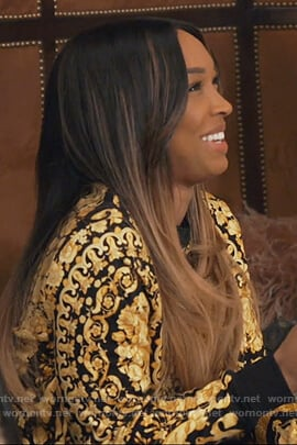 Malika's black and gold print sweatshirt on Keeping Up with the Kardashians
