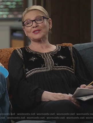 Joan's black embroidered top on Life in Pieces