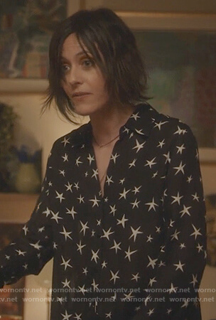Paige's black star print blouse on Grown-ish
