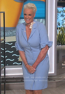 Brigitte Nielsen's blue bow sleeve suit dress on The Talk