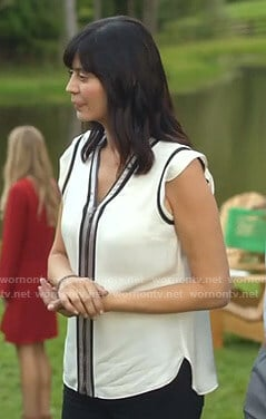 Cassie's white zip-front top on Good Witch