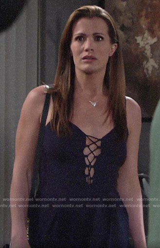 Chelsea's navy lace-up front jumpsuit on The Young and the Restless