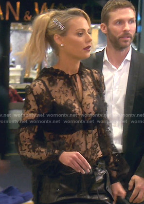 Dorit's black tie neck lace shirt on The Real Housewives of Beverly Hills