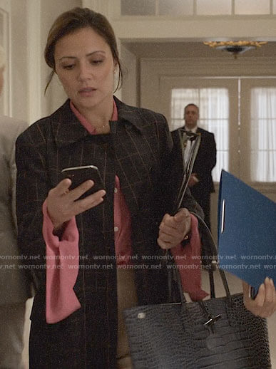 Emily's checked coat and leather tote bag on Designated Survivor