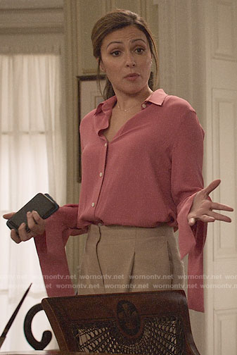 Emily's pink blouse with flared cuffs on Designated Survivor