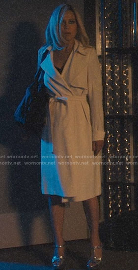 Jett's white trench coat and silver sandals on Jett