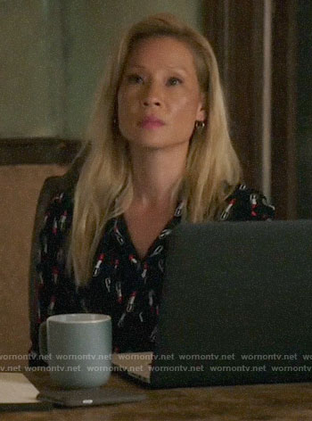 Joan's black lipstick print blouse on Elementary