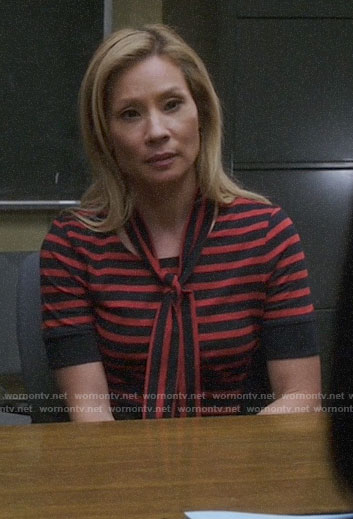 Joan's red striped tie-neck top on Elementary