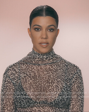 Kourtney's leopard print turtleneck top on Keeping Up with the Kardashians