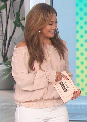 Carrie's pink ruffled off shoulder top on The Talk
