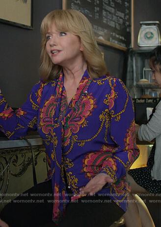 Dorothy's printed tie neck blouse on Jessica Jones