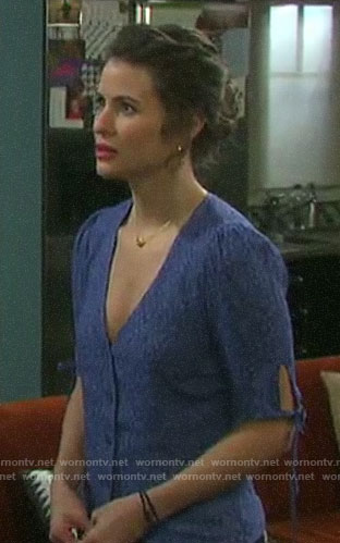 Sarah's blue floral v-neck top with tie sleeves on Days of our Lives