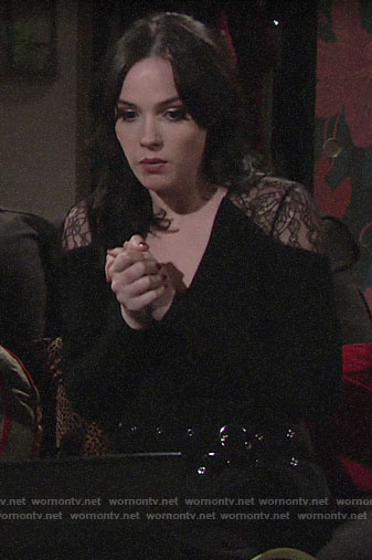 Tessa's black lace shoulder top and belted pants on The Young and the Restless