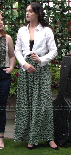 Tessa's green butterfly print pants on The Young and the Restless