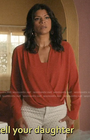 Xiomara's orange draped front blouse on Jane the Virgin