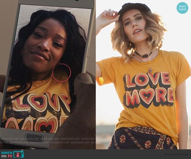 Love More Tee in Mustard by Dazey LA worn by Kym (Keke Palmer) on Scream