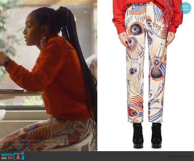 Peacock-Feather-Print Jeans by Dries Van Noten worn by Zoey Johnson (Yara Shahidi) on Grown-ish