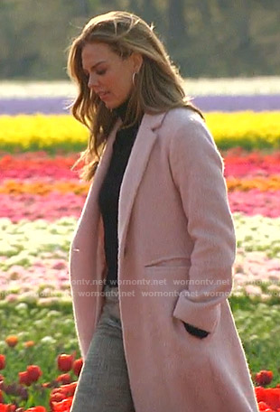 Hannah's pink coat and grey pants on The Bachelorette