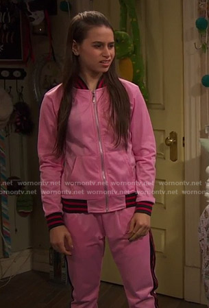 Tess's pink track jacket and pants on Ravens Home