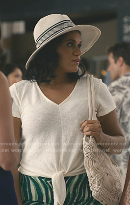 Yoli's white tie front top and knit hat on Grand Hotel