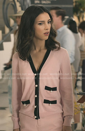 Alicia's pink pearl-button cardigan on Grand Hotel
