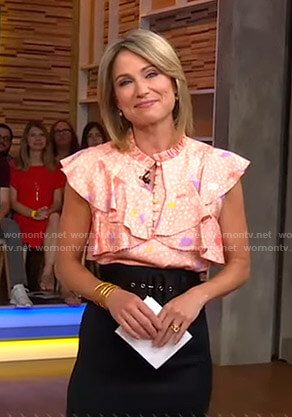 Amy's pink floral ruffled top and black skirt on Good Morning America