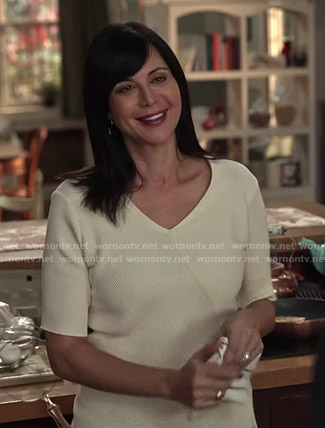 Cassie's white ribbed asymmetric top on Good Witch