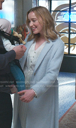 Clare's v-neck blouse and blue wrap coat on Younger