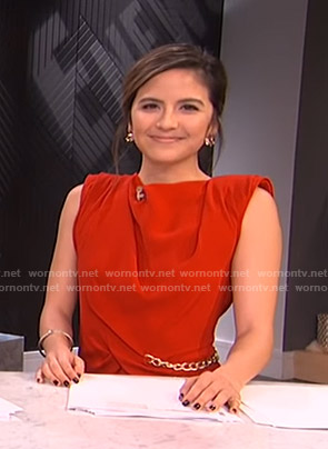 Erin's red chain detail dress on E! News