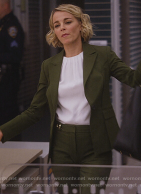 Lizzie's green tie back blazer and white top on Instinct