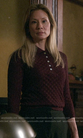Joan's burgundy textured polo sweater on Elementary