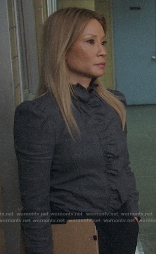 Joan's grey ruffled trim shirt on Elementary