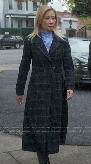 Joan's long checked coat on Elementary
