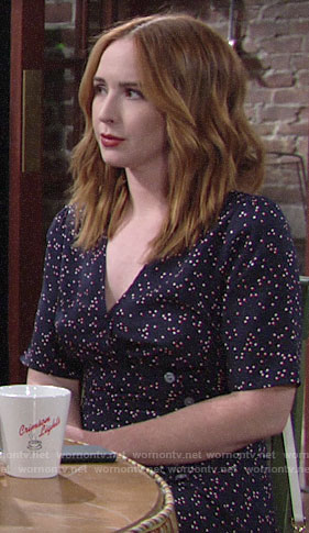 Mariah's navy polka buttoned wrap dress on The Young and the Restless