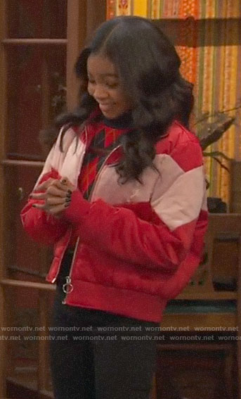 Nia's red chevron puffer jacket on Ravens Home