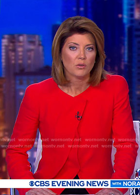Norah's red pleated jacket on CBS Evening News