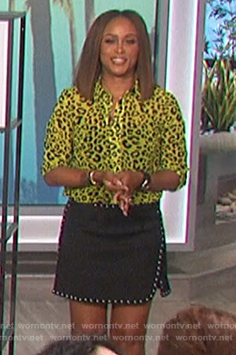 Eve's yellow leopard blouse and studded skirt on The Talk