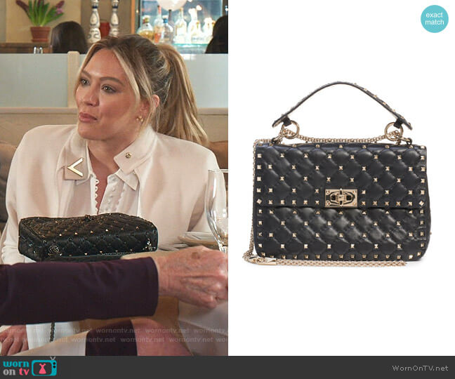 Medium Rockstud Matelassé Quilted Leather Crossbody Bag by Valentino worn by Kelsey Peters (Hilary Duff) on Younger
