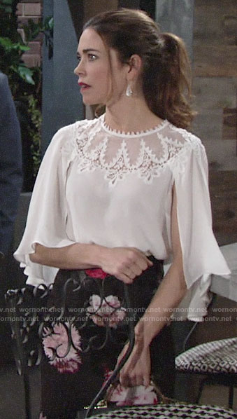Victoria's white lace cape sleeve blouse and floral pencil skirt on The Young and the Restless