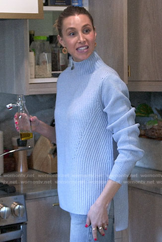 Whitney's blue sweater with buttoned shoulder on The Hills New Beginnings