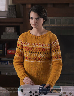 Elodie's yellow knit sweater on Trinkets