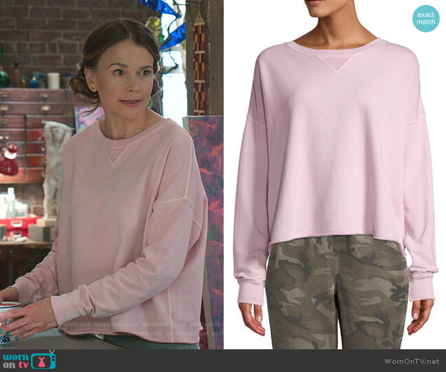 Cropped Raw-Edge Pullover Sweatshirt by AMO Denim worn by Liza Miller (Sutton Foster) on Younger