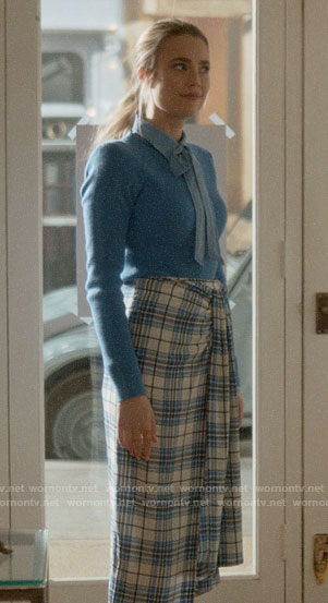 Ainsley's plaid skirt and blue sweater on Four Weddings and a Funeral