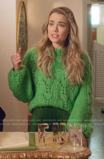 Ainsley's green pointelle knit sweater and pleated skirt on Four Weddings and a Funeral
