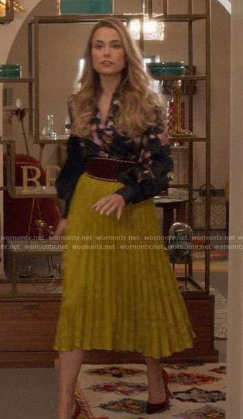 Ainsley's yellow pleated skirt and floral blouse on Four Weddings and a Funeral
